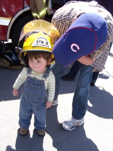 This is our little boy Darcy.  Fire chief and Cubs fan.