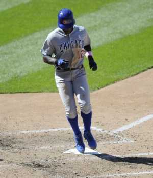 Alfonso Soriano taps home. The Cubs beat the Nationals 2-1
