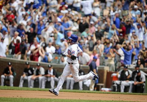 Pitcher Travis Wood runs the bases after hitting a Grand Slam.