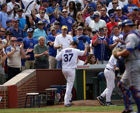 Fans cheer on their ace, Travis Wood after he clubs his two run shot